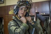 Capt. Anneliese Satz puts on her flight helmet prior to a training flight aboard Marine Corps Air Station Beaufort, South Carolina, on March 11, 2019. Satz graduated the F-35B Lighting II Pilot Training Program in June and will be assigned to Marine Fighter Attack Squadron 121 in Iwakuni, Japan. (U.S. Marine Corps photo by Sgt. Ashley Phillips)