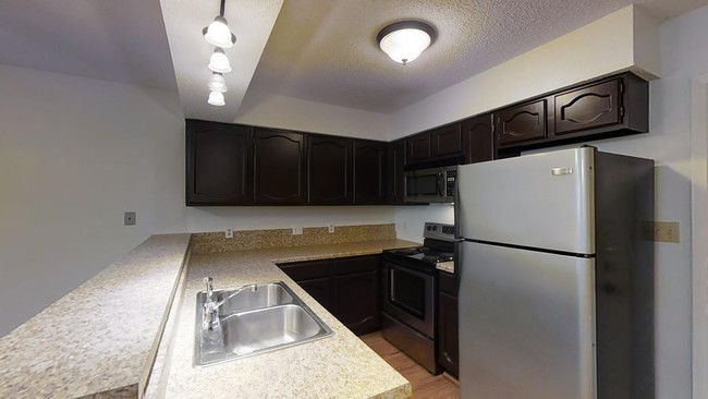 Tucker Property Management/Townhomes & Lofts Apartments