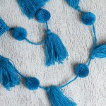 Handcrafted Peacock Blue Cotton Pompom And Tassel Garland Playful Sky Novica
