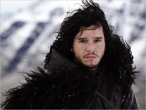 Jon Snow from 'Game of Thrones': a young man dressed in black, with snow in the background.