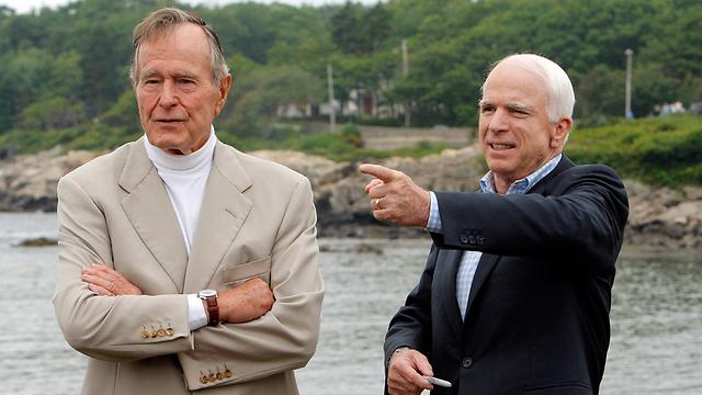 McCain with George H. W. Bush (Photo: Reuters)