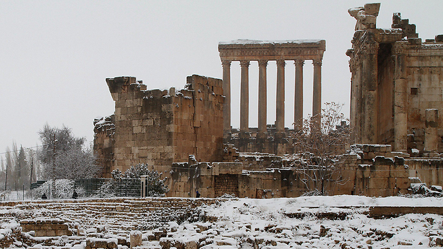 Snow-covered ruins in Lebanon (Photo: AFP)