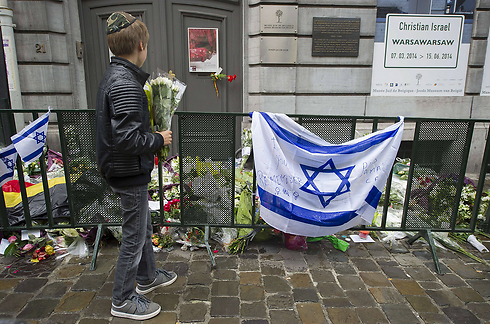 Makeshift memorial at the entrance of the Jewish Museum in Brussles (Photo: AP)