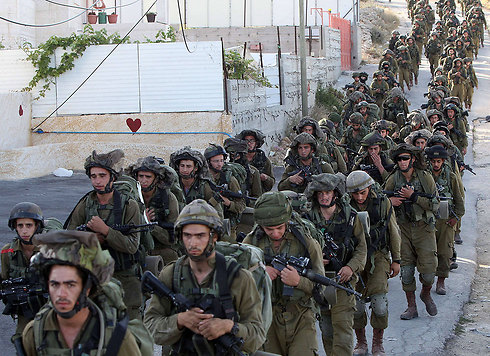 IDF troops search for boys (Photo: AFP)