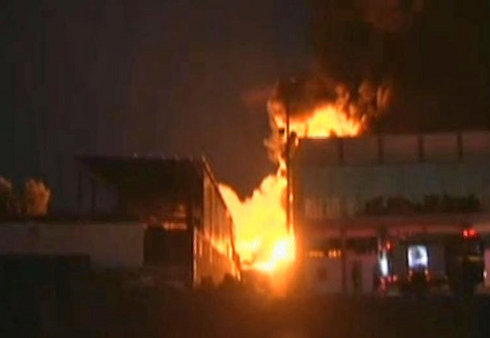 Sderot factory ablaze after a direct hit from a Gaza rocket