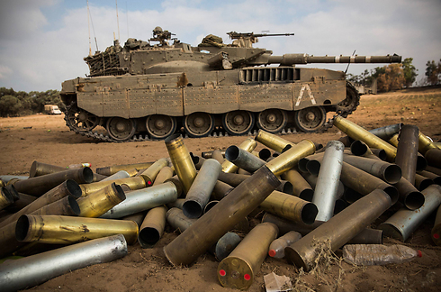 IDF tank and spent ammunition on the Gaza border (Photo: Getty Images)