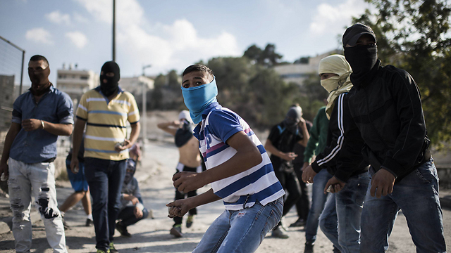 Stone-throwing in East Jerusalem on Thursday (Photo: Getty Images)
