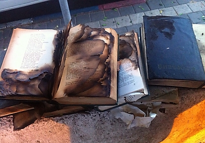 Torched books found outside synagogue