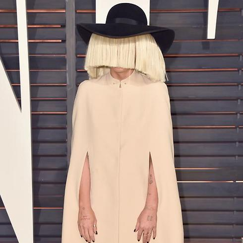 The Singer Is Known For A Tendency To Hide Her Face In Public Earances Photo