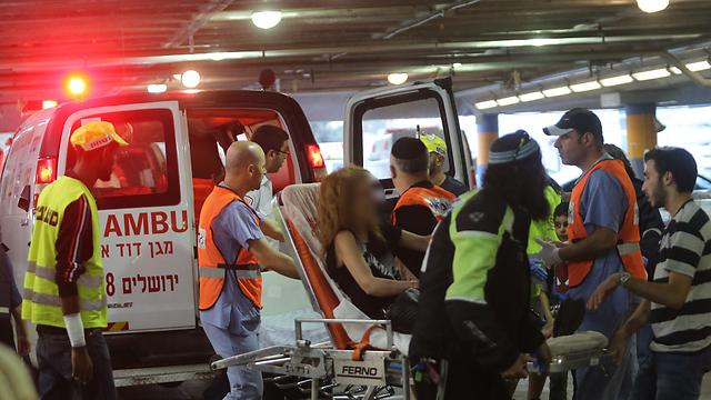 Wounded arrive at the Shaare Zedek Medical Center (Photo: Alex Kolomoisky)