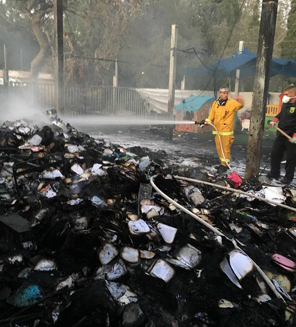 Extinguishing the fire at the Haifa synagogue