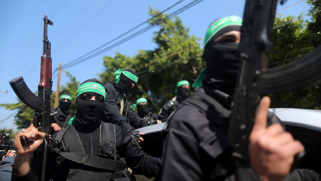 Hamas gunmen during the funeral procession (Photo: Reuters) (Photo: Reuters)