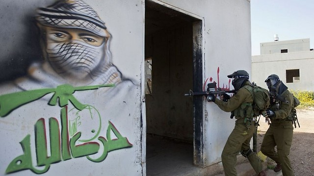 Israeli soldiers train with paintball guns during a drill at an Army base near Elyakim (Photo: AP)