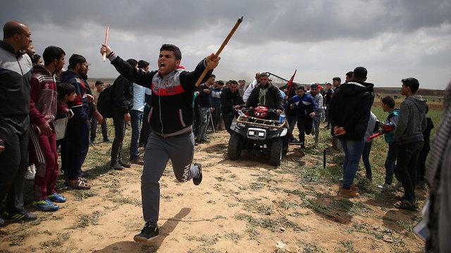 Palestinians protest (Photo: AFP)