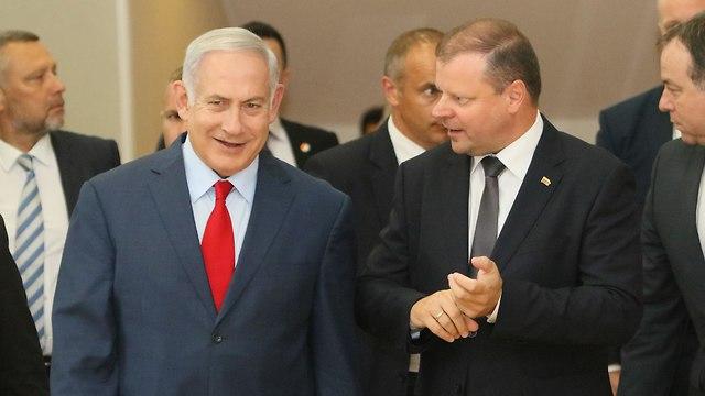PM Saulius Skvernelis with PM Netanyahu (Photo: AFP)