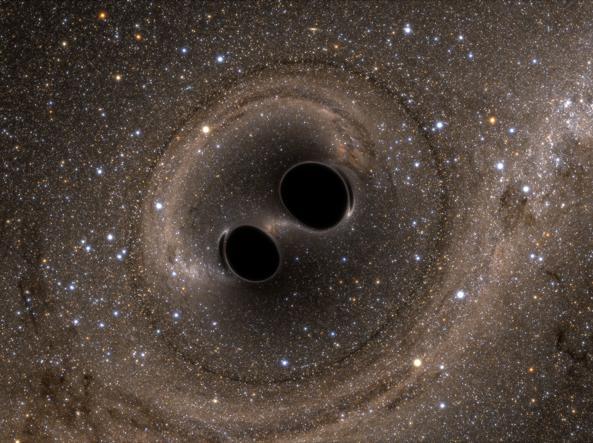 Modello computerizzato della fusione dei due buchi neri che hanno generato le onde gravitazionali che sono state rilevate (Ligo)