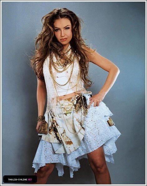https://i0.wp.com/images2.fanpop.com/image/photos/13000000/Thalia-thalia-13098057-472-595.jpg