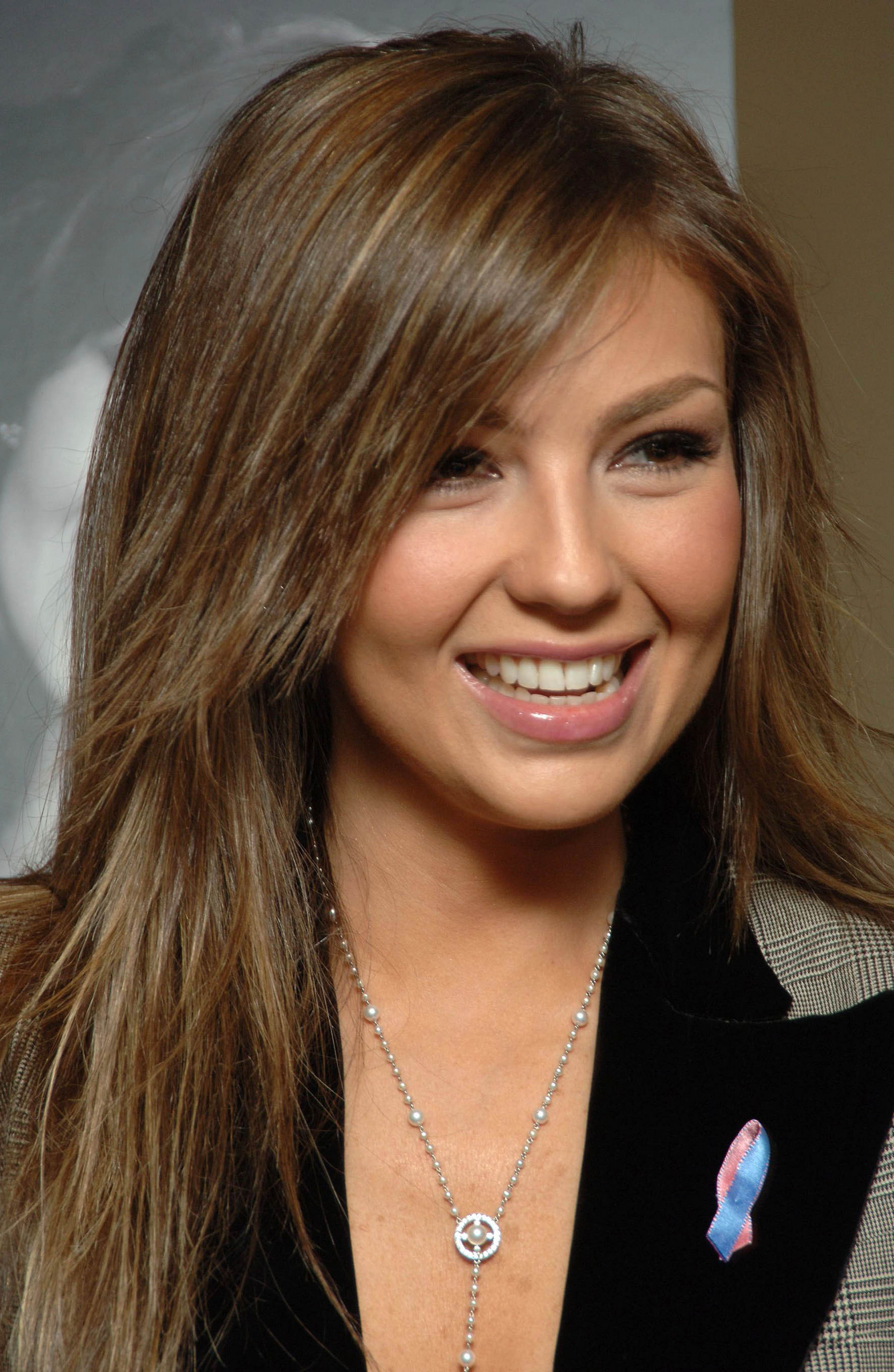 https://i0.wp.com/images2.fanpop.com/images/photos/6700000/Thalia-thalia-6708821-1668-2560.jpg