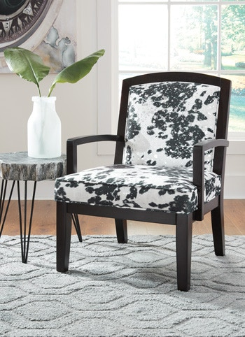 cowhide print accent chair conference table chairs ashley treven a3000096 portland or key home in oregon