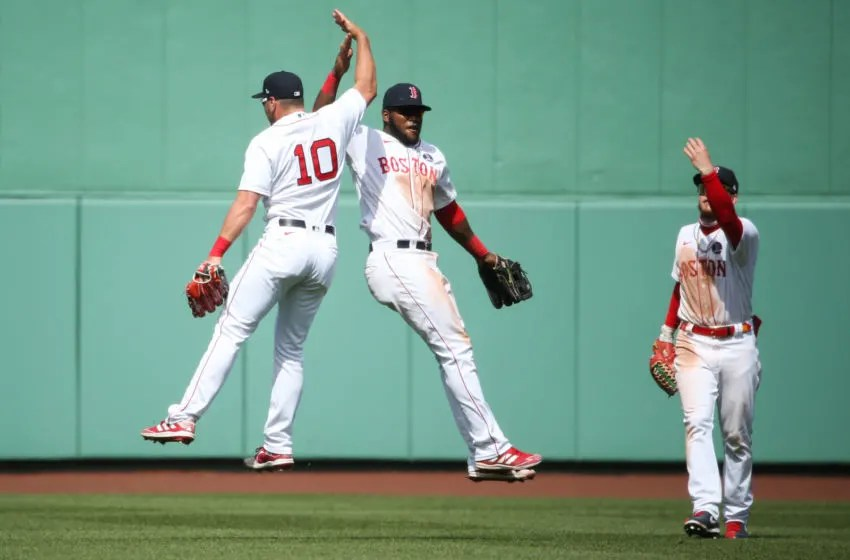 BOSTON, MA - APRIL 19: Hunter Renfroe #10, Franchy Cordero #16, and Alex Verdugo #99 of the Boston Red Sox all celebrate after beating the Chicago White Sox at Fenway Park on April 19, 2021 in Boston, Massachusetts. (Photo by Kathryn Riley/Getty Images)