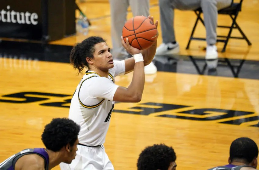 Jan 30, 2021; Columbia, Missouri, USA; Missouri Tigers guard Dru Smith (12) shoots a free throw during overtime against the TCU Horned Frogs at Mizzou Arena. Mandatory Credit: Denny Medley-USA TODAY Sports