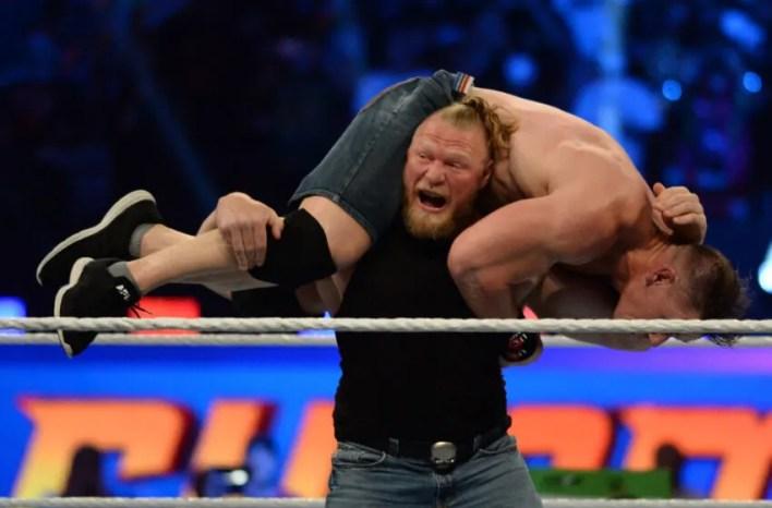 Aug 21, 2021; Paradise, Nevada, USA; Brock Lesnar (black top) returns to WWE and attacks John Cena at SummerSlam 2021 at Allegiant Stadium. Mandatory Credit: Joe Camporeale-USA TODAY Sports