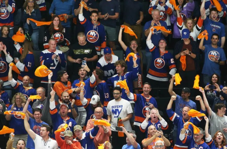 Jun 19, 2021; Uniondale, New York, USA; Islanders fans react after a goal by New York Islanders right wing Josh Bailey (not pictured) against the Tampa Bay Lightning during the second period of game four of the 2021 Stanley Cup Semifinals at Nassau Veterans Memorial Coliseum. Mandatory Credit: Andy Marlin-USA TODAY Sports