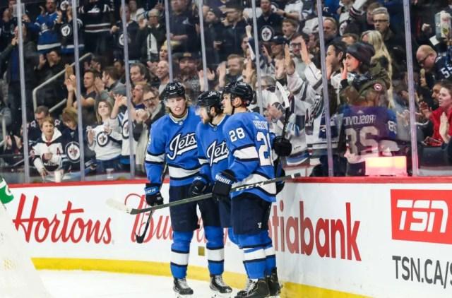 Winnipeg Jets forward Jansen Harkins (58), Patrik Laine (29), Jack Roslovic (28) Mandatory Credit: Terrence Lee-USA TODAY Sports