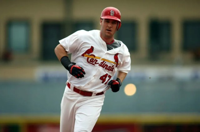 JUPITER, FL - MARCH 29: Ryan Ludwick #47 hits a solo home run against the Minnesota Twins at Roger Dean Stadium on March 29, 2010 in Jupiter, Florida. (Photo by Marc Serota/Getty Images)