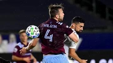 Danny Wilson and Sebastian Lletget fight for a ball.