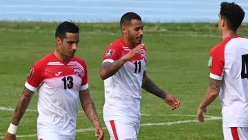 Players from Cuba celebrate a goal.