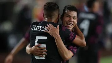 Hirving Lozano and Jonathan Dos Santos celebrating after getting Mexico's final 4-0 over Nigeria.