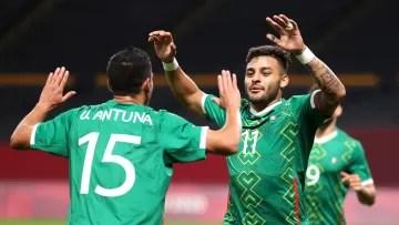 Alexis Vega and Uriel Antuna celebrate a goal.