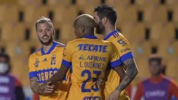 UANL Tigres players celebrate a goal.