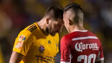 Andre-Pierre Gignac and Rodrigo Salinas face off in a match.