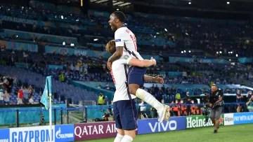 Harry Kane and Raheem Sterling celebrating a goal for England