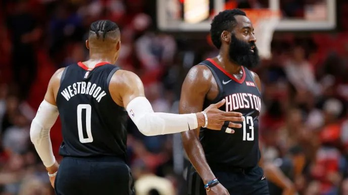 MIAMI, FLORIDA - OCTOBER 18: Russell Westbrook #0 of the Houston Rockets celebrates with James Harden #13 against the Miami Heat during the first half at American Airlines Arena on October 18, 2019 in Miami, Florida. NOTE TO USER: User expressly acknowledges and agrees that, by downloading and or using this photograph, User is consenting to the terms and conditions of the Getty Images License Agreement. (Photo by Michael Reaves/Getty Images)