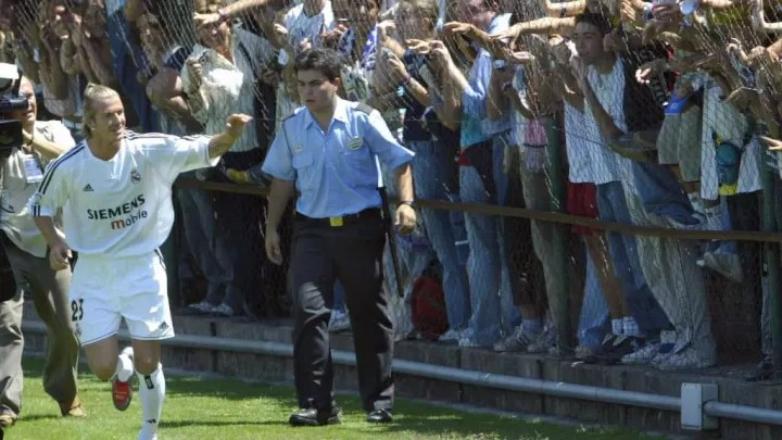 British soccer star, David Beckham waves