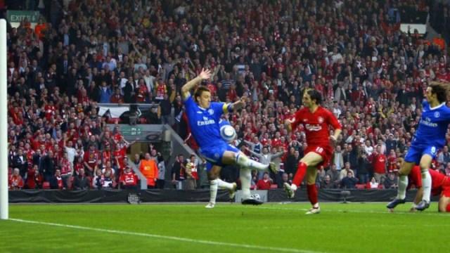 Liverpool's Luis Garcia pokes the ball beyond Chelsea's John Terry