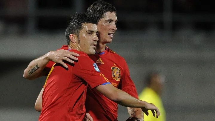 Spain's forward David Villa (L) celebrat
