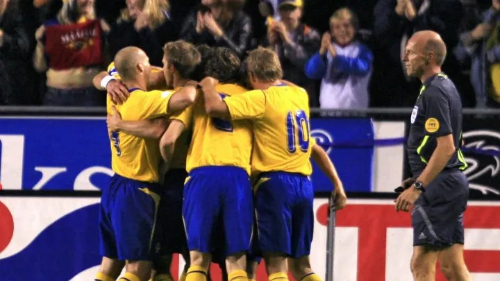 Swedich players celebrate their 1-0 goal
