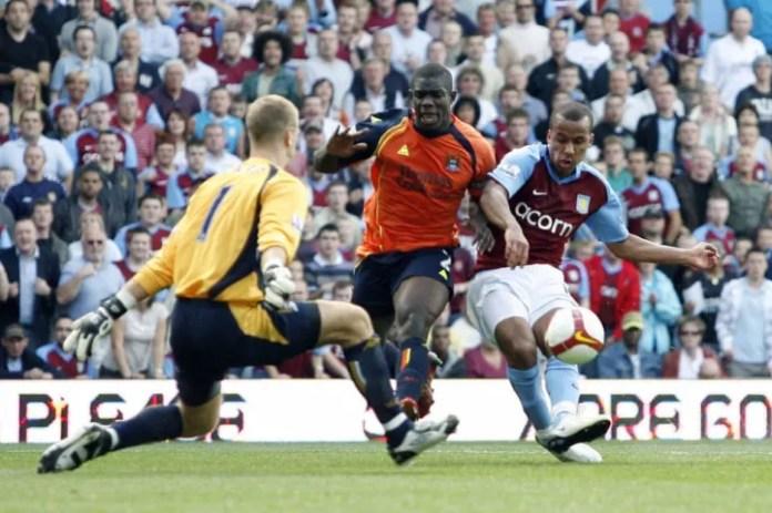 Aston Villa's Gabriel Agbonlahor (R) sco