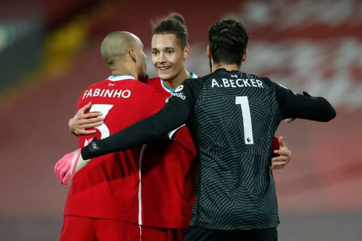 Rhys Williams, Fabinho and Alisson Becker