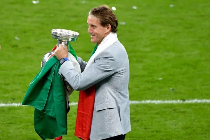 Roberto Mancini coach of Italy celebrates with the trophy at ...