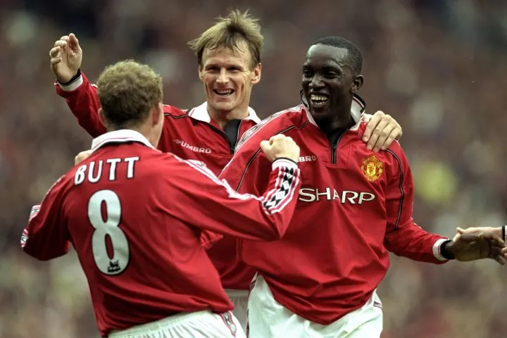 Teddy Sheringham, Dwight Yorke and Nicky Butt of Manchester United