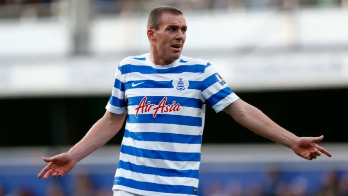 LONDON, ENGLAND - DECEMBER 06: Richard Dunne of Queens Park Rangers gives instructions during the Barclays Premier League match between Queens Park Rangers and Burnley at Loftus Road on December 6, 2014 in London, England. (Photo by Julian Finney/Getty Images)