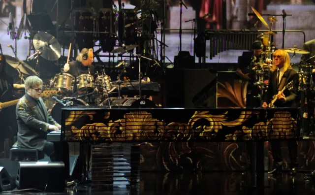 "Elton John plays his ""Million Dollar Piano,"" Blossom, in 2011."