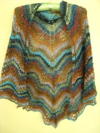 Ravelry: Old Shale Triangle Shawl pattern by Claire Butler