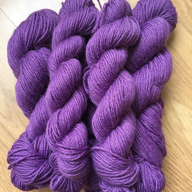 Purple skeins of WYS Airedale DK