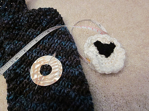 shawl pin and tape measure